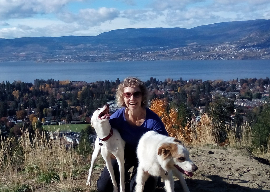 Jackie, an LALDR volunteer and her smiling pups.